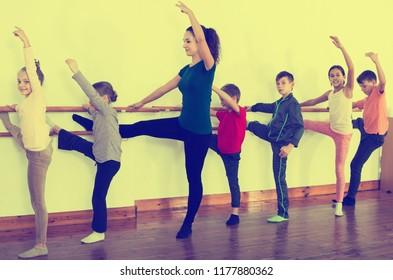 Group of kids dancing ballet in dance class