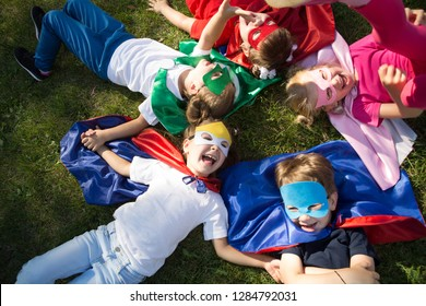 Group kids friends  Superhero playing togetherness and having fun outdoor.