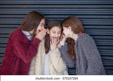 group kids giggling whispering secrets