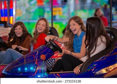 group of kids or girls having fun at fair.