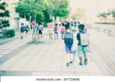 Group of kids going to school together, motion blurr