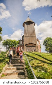 Group of kids going to the wooden church in Poland