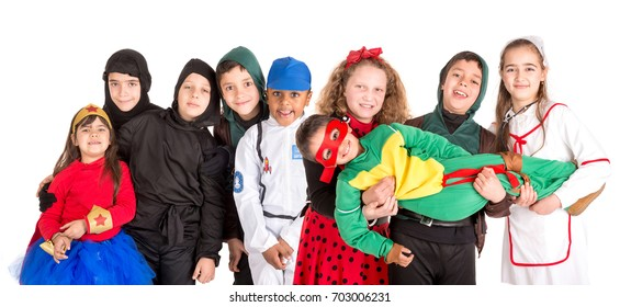 Group of kids in Halloween/fantasy costumes isolated