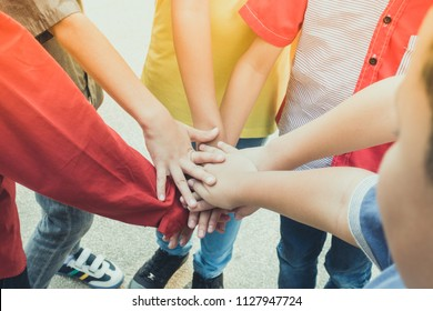 Group kids hands on top ever each other