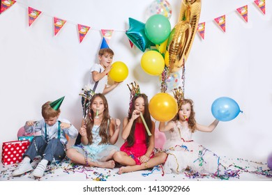 Group of kids having fun and looking happy on birthday party