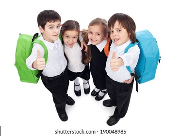 Group of kids holding and giving thumbs up sign - back to school concept, top view