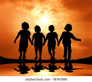 group of kids holding hand and walking during sunset