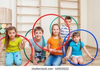 Group of kids holding hula hoops