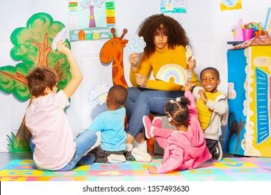 Group of kids in kindergarten discuss weather