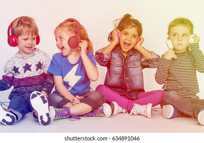 Group of kids listening music with headphone