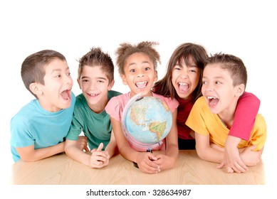 group of kids looking at globe at school isolated in white