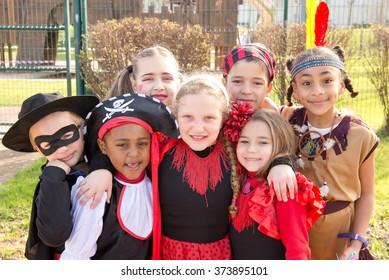 group of kids on halloween posing outside