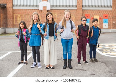 group of kids on the school background having fun