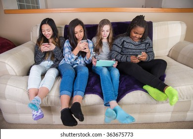Group of kids on their mobile device