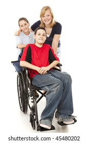 Group of kids with one adolescent boy in a wheelchair.  Full body isolated.