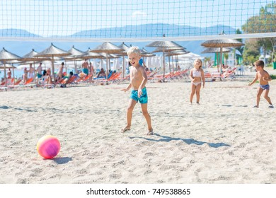 Group of kids playing Beach Volleyball