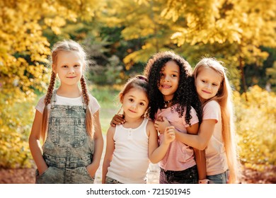 Group of Kids Playing Cheerful Park Outdoors. Children Friendship Together Smiling Happiness Concept