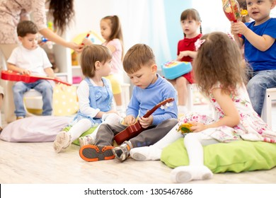 Group of kids playing musical toys. Early musical education in kindergarten or primary school