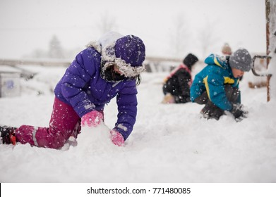 Group of kids playing in the snow in winter time