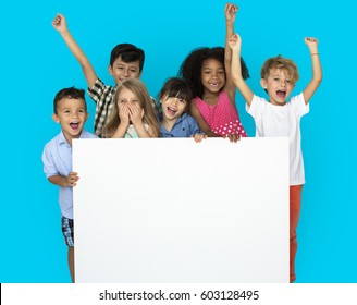 Group of Kids Showing Copyspace Board