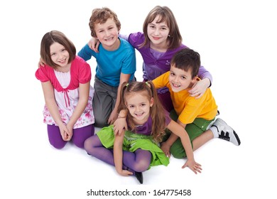 Group of kids sitting on the floor holding to each other - isolated