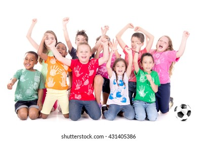 group of kids with soccer ball posing isolated in white