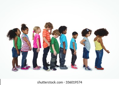 Group of kids standing in a line against a white background