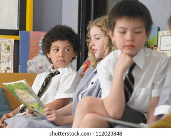 Group of kids studying together in classroom