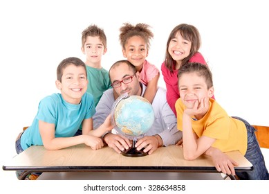 group of kids with teacher looking at globe at school isolated in white