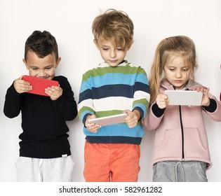 Group of Kids Using Digital Mobile Phone