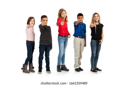 Group of kids in various poses with props, isolated on a white background.