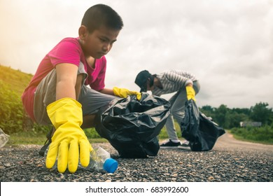 Group of kids volunteer help garbage collection charity environment.