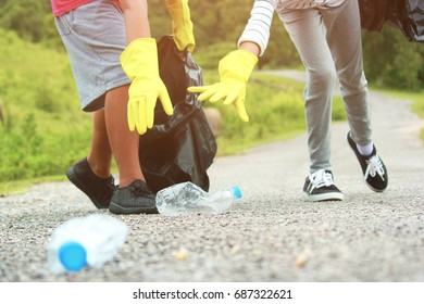 Group of kids volunteer help garbage collection charity environment, selective soft focus.