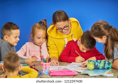 Group kids work homework,isolate on blue background