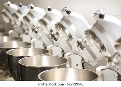 group of kitchenaid mixers