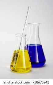 Group of laboratory flasks and beakers empty or filled with a clear liquid on white background
