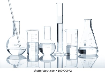 Group of laboratory flasks with a clear liquid, isolated