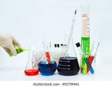 Group of laboratory flasks empty or filled with a clear liquid on blue tint scientific graphics background on a table,science background, copy space,mock up.