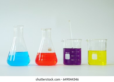 Group of Laboratory Glass Erlenmeyer conical flask and Beaker filled with chemical liquid for a chemistry experiment in a science research lab.