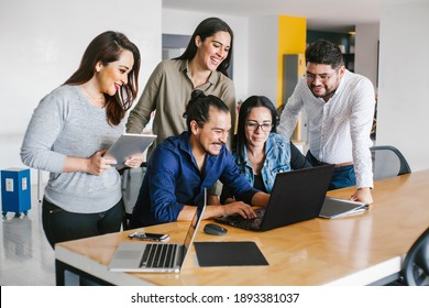 Group of latin business people working together as a teamwork while sitting at the office desk in a creative office in Mexico city