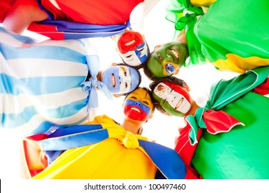 Group of Latin people with flags painted on their face