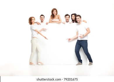 group of laughing friends showing blank banner