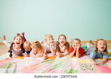 Group of laughing kids laying on floor