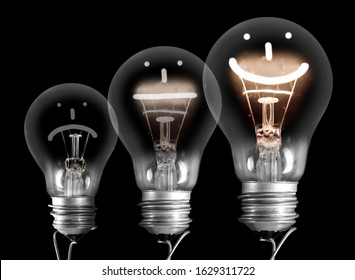 Group of light bulbs going from dark one to a shining one with fiber in Positive, Neutral and Negative emotion isolated on black background.