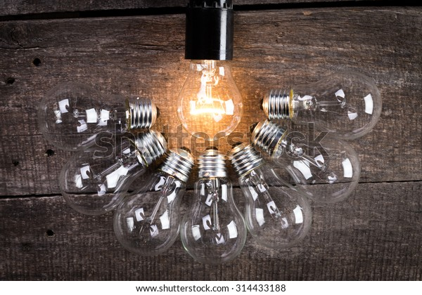 Group of light bulbs on wooden background