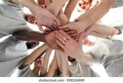 group of like-minded people cupping their palms together