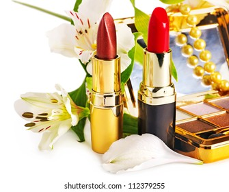 Group lipstick and decorative cosmetics. Isolated.