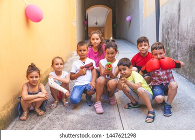group of little boys of different ages having fun and playing together in a courtyard