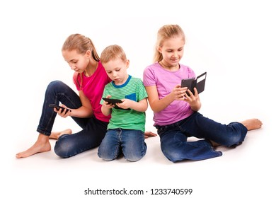 Group of little kids using electronic devices isolated on white.
