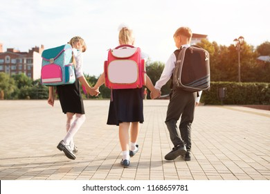 Group of little school kids going to school together.